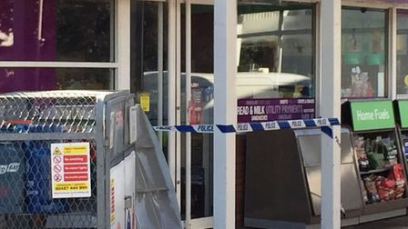 Cordoned off, the BP garage in Dartford Road, March, where a cashier was attacked by a suspected sho