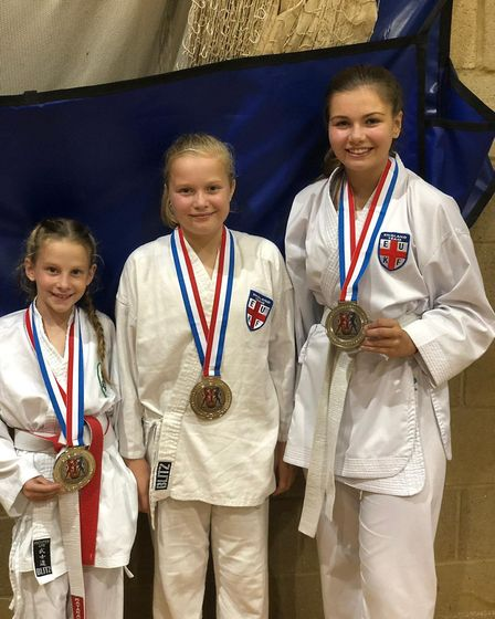 Thaxted Dragons Karate youngsters face the camera at Clacton