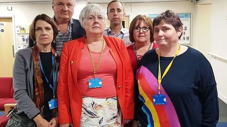 Cllr Lorna Lupre (second right) leads her Lib Dem colleagues out of a stormy meeting at East Cambs D