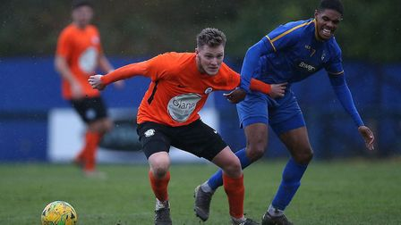 Lewis Clayton of Soham Town Rangers does battle with a Romford opponent last Saturday. Picture: GAVI