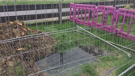 Water-logged hole floods onto path at Witchford Village College – after being left by Anglian Water