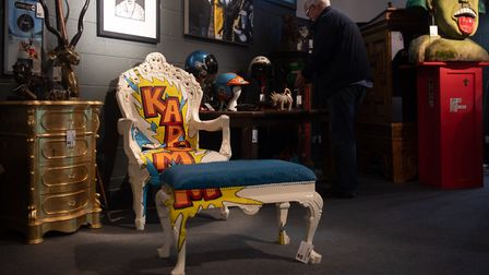 The singer's Jimmie Martin Kaboom armchair and foot stool sold for £4,200. Picture: PA/PA Media