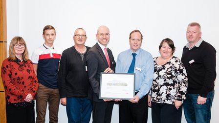 The Friends of March station are presented with their award by Jonathan Denby, Greater Anglia's Head