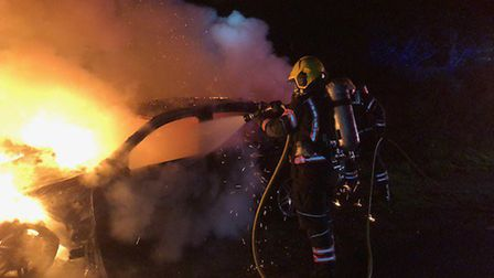 Dramatic pictures show the moment firefighters were left tacking a deliberate car blaze in Thorney o
