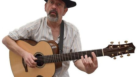 Phil Hare performs at Under The Bridge annoual acoustic concert in March Town Hall.