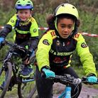 Ely & District Cycling Club juniors Lucas Bowman and Eleanor Stewart racing to victory at Muddy Mons