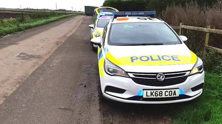Floods Ferry Road near Doddington is closed while a recovery team tidy up a crash scene this afterno