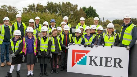 Children mark topping out ceremony at Whittlesey school. Picture: KIER