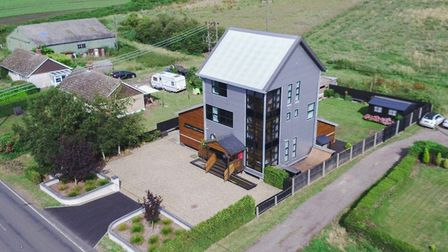 A former derelict mill that was converted into an award-winning modern family home in Prickwillow is