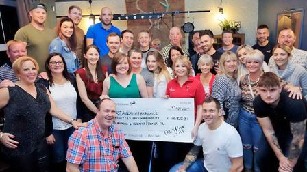 Dozens of bikers put on their leathers to raise £26,820 on a charity ride in memory of Phil Beeton.