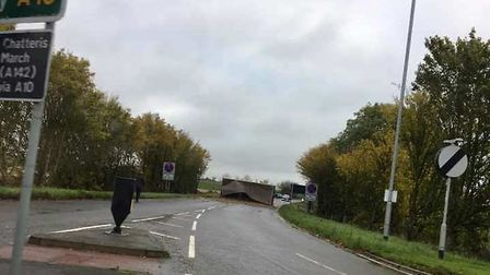recovery work is under way on the A10 near Stretham today after a tractor and its load over turned.