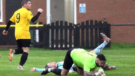Action from March Town's clash with Diss (pic Ian Carter)