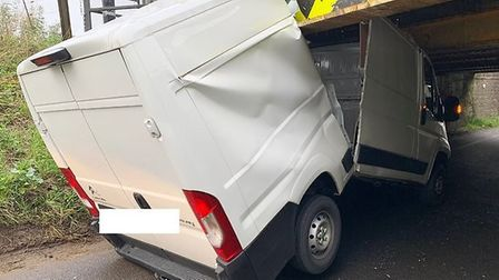 A white van has snapped in half after getting stuck under Stonea Railway Bridge. Picture: CAMBS POLI