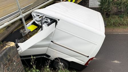 A white van has snapped in half after hitting Stonea Railway Bridge – with a man slightly injured. P