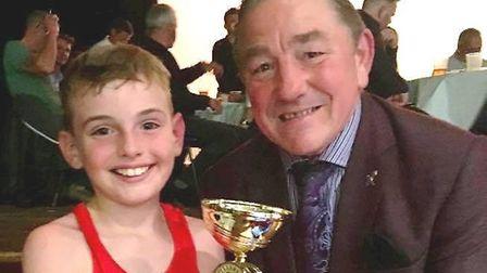Harrison Reynolds of Haddenham & Ely ABC with Dave 'Boy' Green after winning his first bout for the