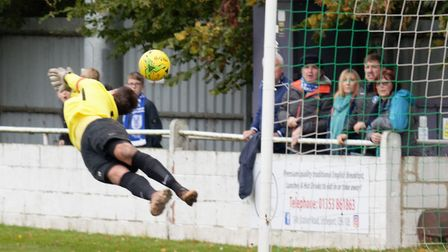 Soham keeper Josh Pope at full length to keep out a shot from Jake Chambers-Shaw (pic Paul Voller)