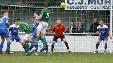 Soham's Cameron Watson gets in a header in the build-up to their second goal against Bury Town (pic