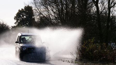 Final moments as cars and vans tackle the flooded Wash Road, Welney, on the A1101 as flood water pou