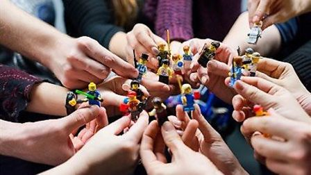 How can we build a better world is the theme of a serious LEGO session led by artist Tim Casson at t