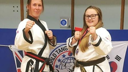 Instructor Master Donna Harvey with Sophia Stanton - 1st in weapons, 1st in forms and 1st in sparrin