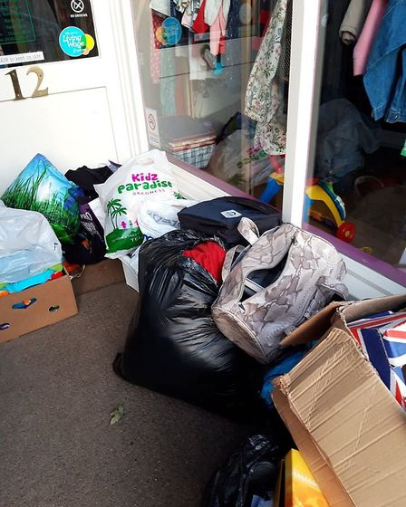A charity shop manager is calling for people to stop flytipping and stealing from the store's doorwa