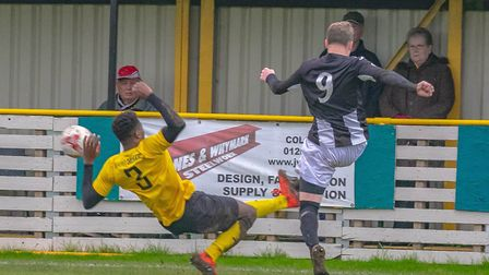 Jake Rudge wins a penalty after a strong challenge from Haynes-Brown Photo: PAUL LEECH