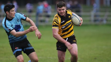 Woodbridge v Ely Tigers: Alfie Ramswell looks for a way round. Picture: STEVE WELLS