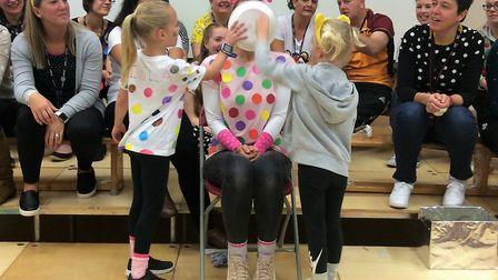 Several lucky pupils got the chance to 'pie a teacher' at Great Dunmow Primary School to raise money