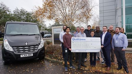 The £18,000 cheque presentation to Eddie's charity from American company Qualcomm to buy a new minib