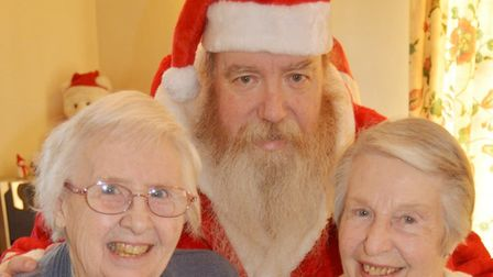 Santa brings Christmas magic at Lily House fayre in Ely. Picture: MIKE ROUSE