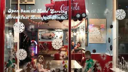Happy customers enjoying the recycled Christmas display at Shooters American Diner on March riversid