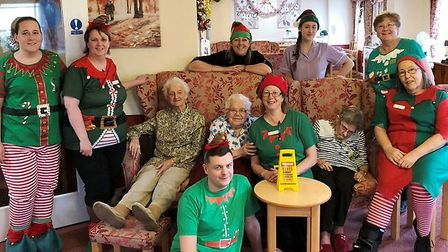 Care home staff dress up as Christmas elves to bring cheer in Chatteris. Picture: LORNA JONES