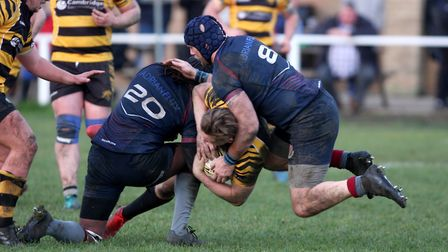 Ely Tigers man Matt McCarthy is stopped in his tracks against West Norfolk. Picture: STEVE WELLS