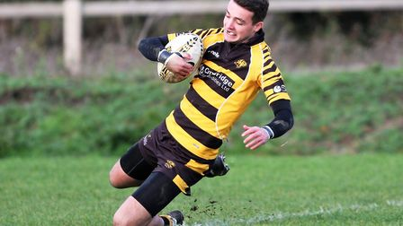 Jake Alsop touches down for Ely Tigers' first try against West Norfolk. Picture: STEVE WELLS