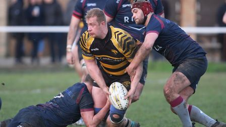 Scott MacFarlane looks to offload the ball during Ely Tigers' game against table-topping West Norfol