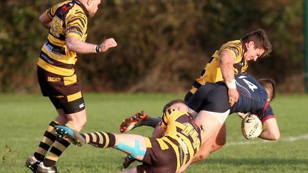 Ely Tigers man Jim Storrey stops a West Norfolk attack last Saturday. Picture: STEVE WELLS