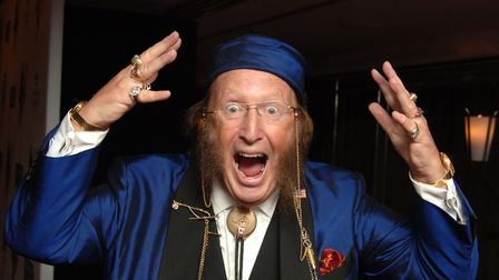A collection of personal effects that belonged to John McCririck raised almost £30,000 at auction. P