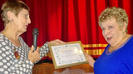 Susan Piper (right) was recognised for her service to City of Ely Flower Club at an open evening thi