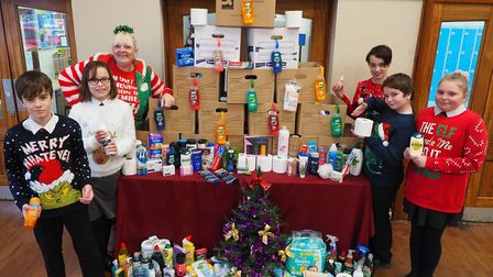 Festive students collect donations for Soham Hygiene Bank. Pictured is Deion Hobbs, Poppy Baines, Mr