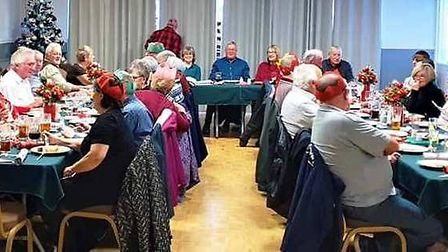 Walking footballers and their families enjoy a festive lunch at their Christmas party. Picture: FACE