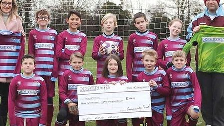 Manea Strikers Under 12's Blue received a cheque from Stainless Metalcraft as part of the firm's com