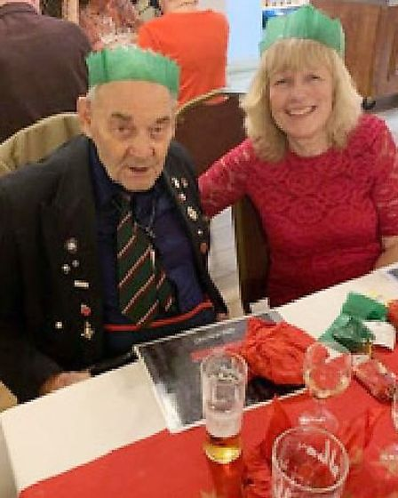 War hero Tom, 91, enjoys Christmas meal at veterans club in March with his daughter-in-law Ann. Pict