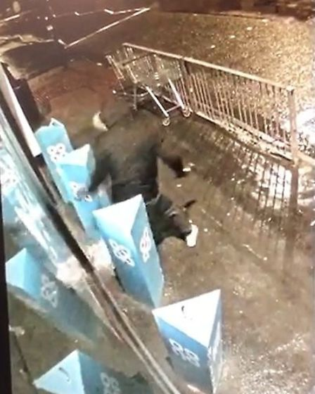 CCTV images of the moment a man tried to smash his way into a Co-op store with a hammer. Picture; CA