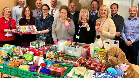 Council staff bring festive cheer to families with foodbank donation. Pictured with the reverse adve