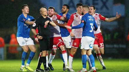 Two men were arrested after alleged racist behaviour at Peterborough United's match on Boxing Day. P