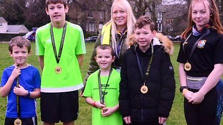Junior runners collected their end-of-season awards, presented by Sarah-Jane Macdonald. From left: L