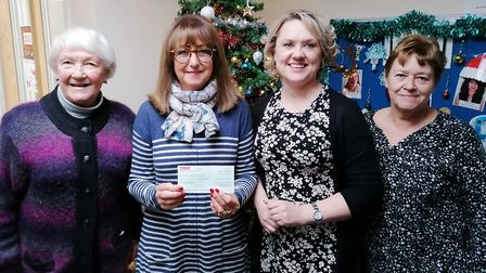Charity fundraising for Ely Fen House by Ely Flower Club. Pictured is Patricia Simmonds, Margaret Do