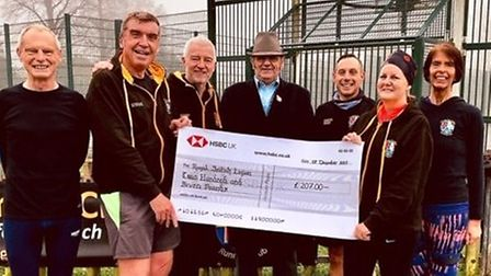 Three Counties Running Club members present a cheque to Mr Ian Gray on behalf of the Royal British L
