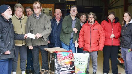 A cheque of £303 was presented to Ely gardening charity EARTH after equipment no longer needed was s