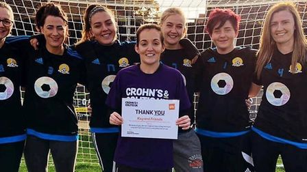 March Town Ladies team: Kayleigh Churchyard (centre) and teammates with their Crohn's & Colitis UK c